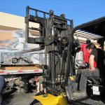 Carefully forklifting the 7,000 pounds of delicate equipment